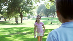 Slow Motion Shot Of Children Playing Catch With Ball In Park Stock Footage