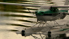 Alaskan float plane docking with pilot stepping out - stock footage