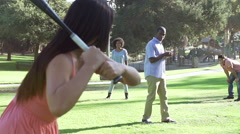 Slow Motion Sequence Of Friends Playing Baseball In Park Stock Footage