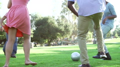 Slow Motion Sequence Of Friends Playing Soccer In Park Stock Footage