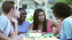 Group Of Friends Celebrating Birthday Outdoors Together - stock footage