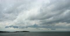 4k sparkling ocean sea water waves surface&coastal rock coast cloud cloudscape. Stock Footage