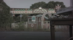 Disused ride at abandoned theme park. 0559 Stock Footage