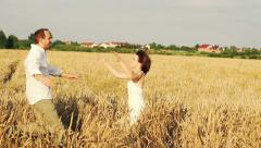 Stock Video Footage of Couple in love hug, embrace on wheat field, super slow motion, 240fps HD