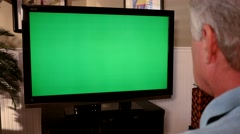 Man Watching Greenscreen TV Close Up 4K Stock Footage