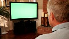 Man Watching Greenscreen TV 4K - stock footage