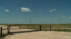 Windmills on ranch with cattle gate in Oklahoma panhandle Stock Footage