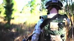 U.S. Marines conduct Tank Maneuvers - Walking behind soldiers on patrol Stock Footage