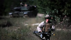 U.S. Marines conduct Tank Maneuvers - Marine running away from Tank Stock Footage