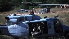 U.S. Marines conduct Maneuvers - Helicopter lifts off from field Stock Footage