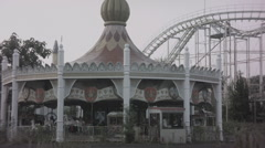 Carousel and roller coaster at abandoned theme park. 0553 Stock Footage