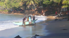 Fishermen pulling boast out of sea in Mirissa. Stock Footage