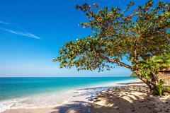 beautiful tropical beach with  sea view, clean water & blue sky. nature backg - stock photo
