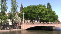 France - Alsace - Bridge in Strasbourg with the Cathedral in the background Stock Footage