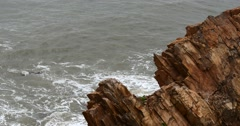 4k sparkling ocean sea water waves surface&coastal rock reef coast surge shore. - stock footage