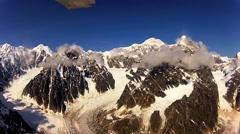 Flying through the Alaskan range to Denali Stock Footage