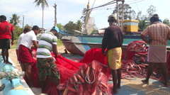 Local fishermen working on a beach in Weligama. Stock Footage