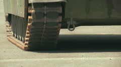 U.S. Army Tank practice fire - Close up of Continuous tank tracks Stock Footage