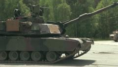 U.S. Army Tank practice fire - Tank moving into position Stock Footage