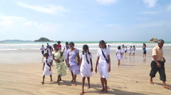 Local people on the beach in Weligama. Stock Footage
