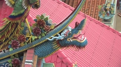 Intricate dragon carvings on the roof of Temple Stock Footage