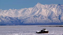Alaska's Knik Arm with old boat in winter Stock Footage