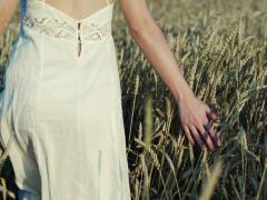 Woman running through wheat field, super slow motion, 240fps NTSC Stock Footage