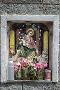 Catholic icon at crossroads Stock Photos