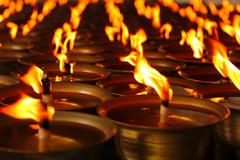 Oil candles in a Chinese temple Stock Photos