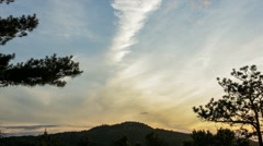 2 layers of clouds over mountain peak Stock Footage