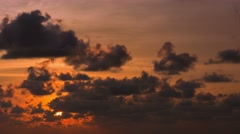 The sun sets in the cloud. timelapse in orange tones Stock Footage