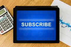 subscribe word on digital tablet - stock illustration