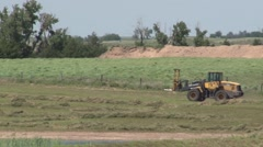 Tractor Driving Across Field - stock footage