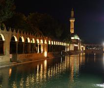 Reflections of halil rahman cami on  the pool of abraham Stock Photos