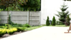 Caregiver walking in the garden with disabled patient film Stock Footage