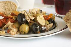 Olive and mushroom antipasti Stock Photos