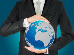 Businessman standing posture hand holding earth icon isolated Stock Photos