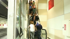 Crowd of people using the escalator Stock Footage