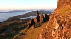 Walker Old Man of Storr sunset Trotternish Peninsula Skye Scotland Stock Footage