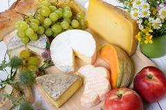 Stock Photo of assortment of french cheeses and seasonal fruit