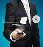Businessman standing posture hand hold mobile phone analyze graph isolated Stock Photos