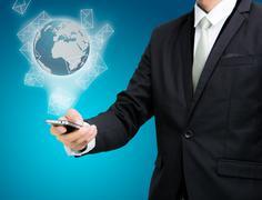 Businessman standing posture hand hold mobile phone global marketing isolated Kuvituskuvat