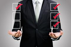Stock Photo of businessman standing posture hand holding strategy flowchart isolated