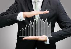 businessman standing posture hand holding graph finance isolated - stock photo