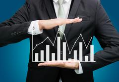 Businessman standing posture hand holding graph finance isolated Stock Photos