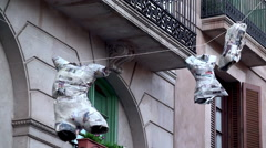 Art-installation on the street of Barcelona. Mannequins with glued newspapers. Stock Footage