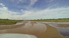 Off-Road Driving On Shallow River With Sunny Day Stock Footage