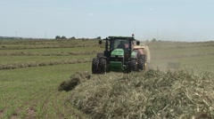 John Deere Tractor Bailing Close Front View - stock footage