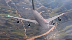 Aircraft flying over the mountains - stock footage