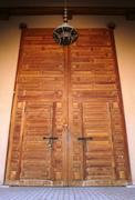 Large wooden door inside the badi palace in marrakech, morocco Stock Photos